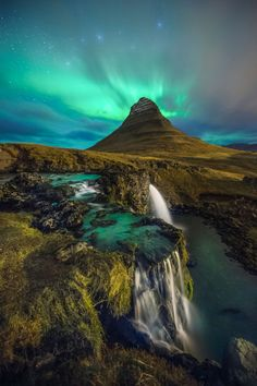 The beauty of Kirkjufell Mountain is in its nearly symmetrical shape and freestanding location—which is probably why it's the most photographed mountain in Iceland. It's also a particularly beautiful spot to watch the Northern Lights when they're active from October to March.
