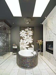 Lily Ensuite contemporary bathroom.  Beautiful!  I love the slab of Calacatta marble on the fireplace.