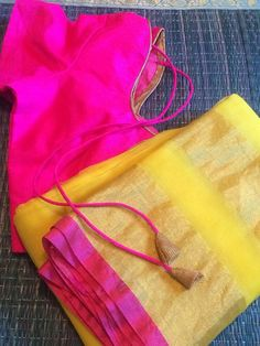 Beautiful Yellow Organza Kota saree. Saree looks amazing with the contrasted pink pre-stitched blouse. Wear for a party or just like that this saree