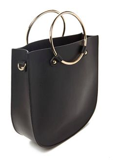 This structured piece of perfection that looks like it came straight from  the runway. Handbags and Purses 348d72eeee322