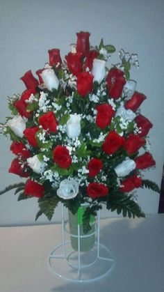 More then 4 dozen red and white rose buds are in this arrangement with white babys breath. Approx height is 22 to 25 inches including green styrofoam vase. Green styrofoam Vase is approx 3 x 8 inches. White stand not included Cemetery Vases, Cemetery Decorations, Cemetery Flowers, Church Wedding Decorations, Red Flowers, Pretty Flowers, White Roses, Red Roses, Red Flower Arrangements