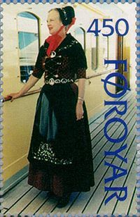 Margrethe II of Denmark in a costume of the Faroese people. Stamp FR 302 of Postverk Føroya, Faroe Islands, issued 14 January 1997