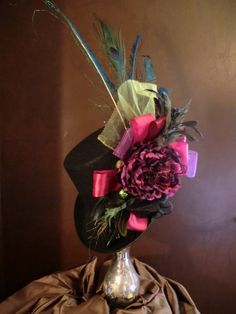 Black Top Hat, Victorian Style with Peacock Feathers, Pink/Purple Ribbons and a Purple Flower. $75.00, via Etsy.