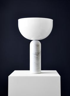 White Marble Table Lamp A trick of the light? The bowl shaped acrylic shade appears to teeter upon a white marble base. The soft geometric forms have a sculptura… White Table Lamp, Light Table, Deco Design, Lamp Design, Marble Lamp, White Acrylics, Lighting Solutions, White Marble, Decoration