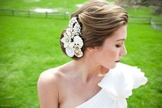 retro bridal updo--- see Retro and Vintage Inspired Bridal hair style guide here http://www.wedmepretty.com/go-for-a-retro-updo-with-a-vintage-inspired-piece/