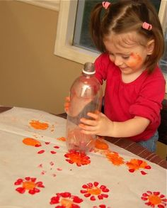 this craft can double with the flower curtain craft I previously posted. If you let the paint dry on the bottles, you can cut the flowers off the bottom and add color to the curtains.