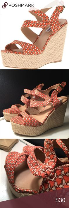 Steve Madden Jenny Orange 9.5 Espadrille Wedges Adorable platform wedges in a coral orange pattern.  Not sold in stores anymore :). Gold buckle closure and straps cross cross in a unique way.  These were worn once- not sure exactly the physics of it, but a bit of nail polish spilled at the inside one shoe towards the heel- I removed with rubbing alcohol, but it wiped away some of the footbed material!  See the last pic :).   Doesn't take anything away from these cute shoes-! Steve Madden…