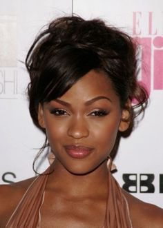Loose and Lovely.  A mix of braids and curls pilled up on the crown with side swept bangs.