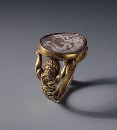 Sixteenth-century ring set with a cameo portraying Cupid in a seahorse-drawn chariot. (The Hermitage Museum)
