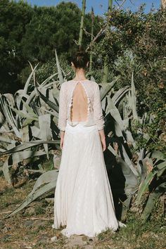 PATTI SMITH - A delicate design, seemingly quite restrained, with a sensual plunging back that becomes the unexpected focus. An original wedding dress that, like the great Patti Smith who it's named after, represents femininity with personality that doesn't conform to conventional standards.