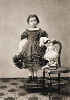 Girl with her doll, 1860s - Another one that appears to be propped up on a stand, so possibly post-mortem