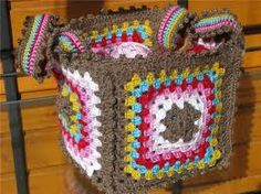 Couldn't find the pattern...but like the idea of a granny square purse.  :)