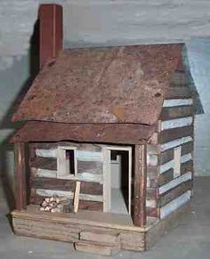 Miniature handcrafted folk art farmhouses and collectible primitive country accents