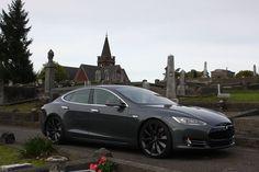 Tesla model S in dark gray.