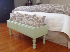 Upcycled dresser drawer to little storage on legs -- perfect for corralling those throw pillows off the bed each night!