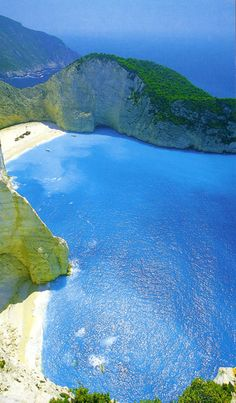 Kefalonia, Greece (Myrtos Beach) one of the best islands in Greece so many beaches with their own distinct personality here. This one pictured is one of the most beautiful but extremely hot and difficult to climb to.