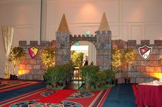 Escape to a mid-evil castle with decorative armored shields on the walls  #kidsparty #mid-evil #castles