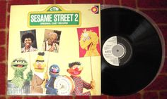 I was amazed at how good this record sounds - obviously the children didn't play with it!  This is the original cast recording, copyright 1977 featuring:  Will Lee as Mr. Hooper  Loretta Long as Susan  Matt Robinson as Gordon  Carroll Spinney as Big Bird and Oscar  Frank Oz as Cookie Monster, Grover and Bert  Jerry Nelson as Herbert Birdsfoot, Herry Monster, Farley, Marty and Little Jerry  and Jim Henson as Ernie CTW Sesame Street 2 LP 12 Record Axis EMI Rare