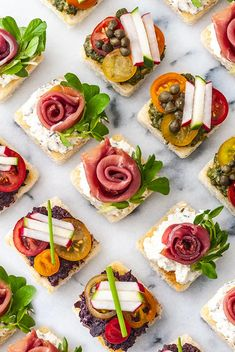Here you'll find 20 appetizers, cocktails and sweet treats for a perfectly lovely bridal shower! They're so incredibly tasty that you'll impress even the pickiest mother-in-law! They're also pretty, so easy and delightfully colorful too.