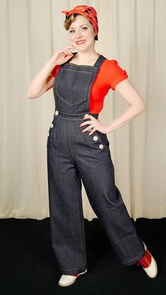 1940s NK Denim Sailor Overalls:These are nice 1940s style heavy denim overalls. They are high waisted and feature large vintage-y buttons. There are four functioning buttons in the front sailor style and two in the back to hold the straps in place. You can criss-cross the straps and wear them straight. The back also has two large patch pockets and one pocket on the... $130.00