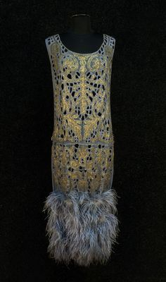 Art Deco Beaded Dress With Cutwork And Feathers - Sleeveless Periwinkle Chiffon Having Cutwork Neckline, Front And Back Panels, Embroidered In Periwinkle Silk Floss And Metallic Gold With Crystal And Clear Beads, Paste Bands At Side, Four Rows Of Marabou Feathers At Hem   c. 1920's  -  Whitaker Auctions
