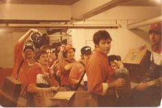 """This had to be a Sunday ...line up! In the old days, beer was not sold in Chicago until noon under what was and is still known as the """"blue law""""   Vendors waiting in the comm. to go out. Looks like...l - r...Mike Ginzberg, Ron Rubenstein,..perhaps Gary Newman?, Eli Lawrence, perhaps Ashko? Ron Pollakov and Steve Drexler is sitting   ....in 1980"""