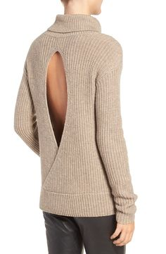 A hint of luxurious cashmere softens tis rib-knit turtleneck sweater styled with slouchy dropped shoulders and an open keyhole back for a dramatic, skin-flaunting twist.