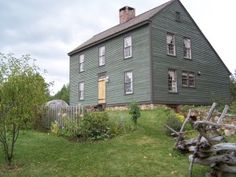 Saltbox House with a long, pitched roof that slopes down to the back. The house is just one story in the back where the rest of the hose is a full two-story. the wood worked house has the resemblance to the wooden lidded box that salt was once kept in.