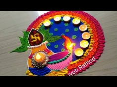Rangoli Art is the traditional art of India. It is believed that having Rangoli Design in front of your house brings good luck apart from home decoration pur...