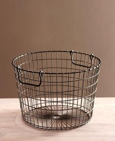 Potato Basket. Simple but great. Fasten chain or rope to each handle  and use for hanging plants too.