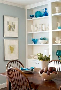 pretty shelves.  you could get thrift store bottles, bowls, containers, and spray paint them.