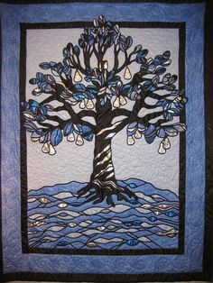 """""""Tree of Life"""" by Laura Delis. Stained glass tree quilt. 2012 Springville (Utah) quilt show.  Photo by Shannon Caywood."""