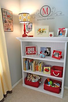 Something like this color scheme for the boys room...Gray walls (leftover bedroom paint) with red and light aqua accents, and maybe some small splashes of yellow.