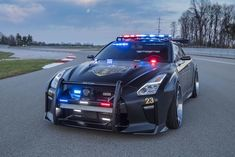 2017 New York Auto Show features one interesting supercar which is the police version of Nissan the most powerful car - GT-R. Nissan Gt R, Nissan 350z, Police Car Lights, Police Cars, Police Vehicles, Auto Motor Sport, Motor Car, Nissan Skyline, Skyline Gtr