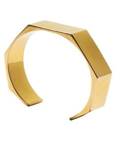 RESORTWEAR: In Cuffs - FROM ALL ANGLES Semi-chunky jewelry in geometric shapes lends a finishing touch to edgy looks like a black maxiskirt or jeans with boots. Tom Binns Design cuff.