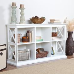 Hayneedle. The Hampton Console Table Stackable Bookcase - White $294.98 55.5 W x 14.5 D x 32 H has holes fo cords. LOVE this for Flat screen TV.
