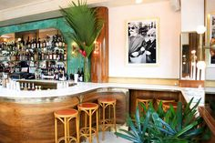 Sauvage is a new restaurant that recently opened in Brooklyn, and has beautiful interior design featuring vintage accents, palms, and gorgeous lighting fixtures. Visit Sauvage in Greenpoint, Brooklyn.