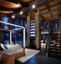 This master bedroom incorporates sleeping area, sitting area and yoga loft as well as a twenty foot fireplace of black granite masonry. Sapele wood and Indian limestone are highlighted with back lit onyx in descending scale represented smoke.    Winner: 2nd Place Residential Greater than 6,000 sq ft, 2011 ASID Arizona North Chapter Design Excellence Award