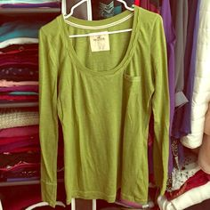 Hollister Green Shirt Long sleeved Hollister shirt. Small pocket design in the front. Scoop neck style. Great condition, only worn a couple of times. Hollister Tops Tees - Long Sleeve