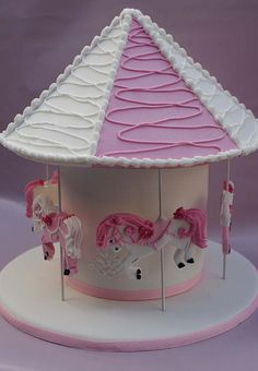 Carousel cake. This is incredibly cute. Almost doesn't look like a cake, but rather a display piece for a girl's bedroom.