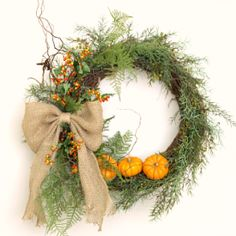 Shows an easy way to attach mini pumpkins to a wreath that anyone can do.