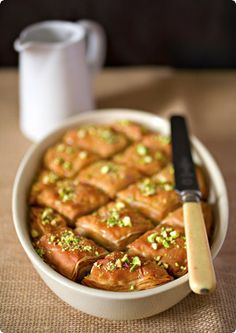 "Temptation, Thy Name is Baklava ~ Baklava with Cardamom, Honey and Pistachios. Ask anyone from the Eastern Mediterranean who makes the best baklava, and chances are they will answer ""we do""!"