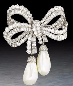 A rare diamond and pearl bow brooch, by Cartier, circa 1960.