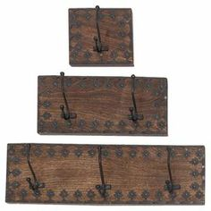 """Featuring floral-inspired metal accents and earthy brown wood, these charming wall hooks add a touch of rustic style to your entryway or foyer.  Product: Small, medium and large wall hookConstruction Material: Metal and woodColor: Brown and blackFeatures:  Six hooksLeaf-like patternDimensions: Small: 6"""" H x 6"""" W x 3"""" DMedium: 6"""" H x 12"""" W x 3"""" DLarge: 6"""" H x 18"""" W x 3"""" D"""