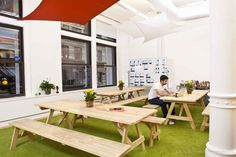 Inspiring Offices - Yipit - Get the feeling of working at a picnic table in the park inside your office!