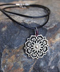 Take a look at this Silvertone Mandala Pendant Necklace today!