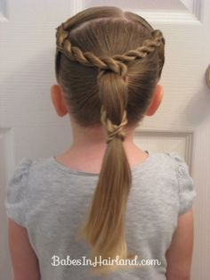 Add some cute twists to a ponytail to jazz up a regular ponytail. BabesInHairland.com #ponytail #hair #hairstyle #toddlerhair #twist #ropetwists #cutehairstyle #littlegirlhair
