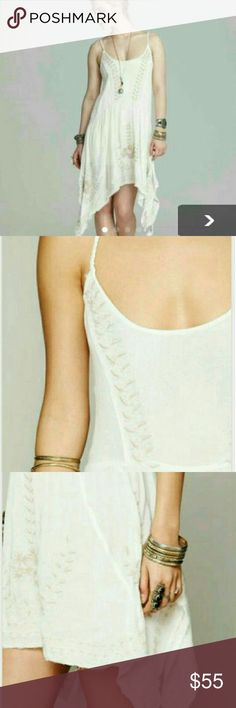 Meadow if Medallions dress in ivory Meadows of Medallions dress in Ivory Size ex-small NWOT Looking to trade for a different free people a slip dress, size ex-small to small!!? Free People Dresses Mini