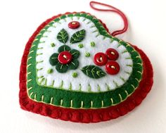 Holly heart felt Christmas ornament, Red & Green heart Holiday ornament with holly berries Holly heart felt Christmas ornament, Red & Green heart felt Holiday ornament, Handmade felt heart Ch Handmade Christmas Decorations, Felt Christmas Ornaments, Christmas Diy, Embroidered Christmas Ornaments, Handmade Ornaments, Beaded Ornaments, Homemade Christmas, Handmade Bookmarks, Christmas Nativity