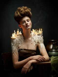 //Noooot a fan of the hair or the eyes... something seems off. BUT I do compeltely adore the candles, the lit candles, and wax shoulders! Yes. Yes. Yes!